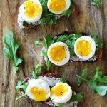 Walnut Ricotta Crostini with Arugula and Soft-Boiled Eggs