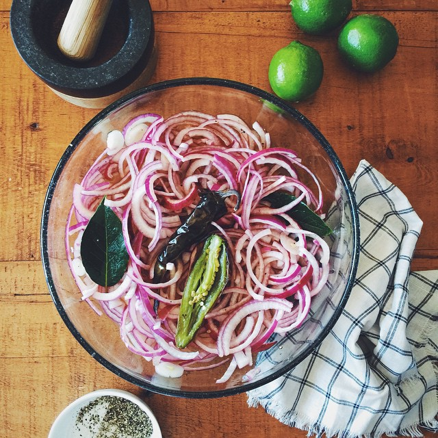 Citrus pickled onions, a topping for pulled pork sammiches. Sliced…