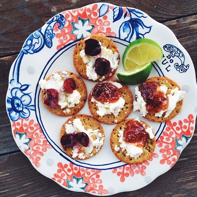 The app situation right now: crackers and goat cheese with 2 toppings. The first is smoked fig jam and fleur de sel. The second is smoked cherry, honey and lime. YUUUUM. Smoke fruit goodies generously provided by my newest foodie friend, @frommyimpossiblytinykitchen.  Thanks Holly :)!!