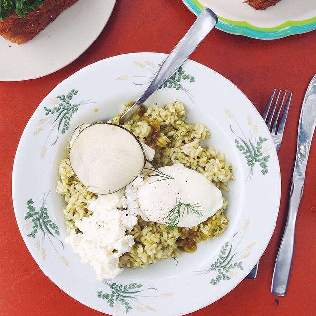 Sorrel Pesto Brown Rice Bowl. This dish was BOMB? Brown rice dressed with sorrel pesto, preserved Meyer lemon, dill, black radish, sheep feta and a poached egg.  Crazy delicious.  Huge flavors. @sqirl_confitures