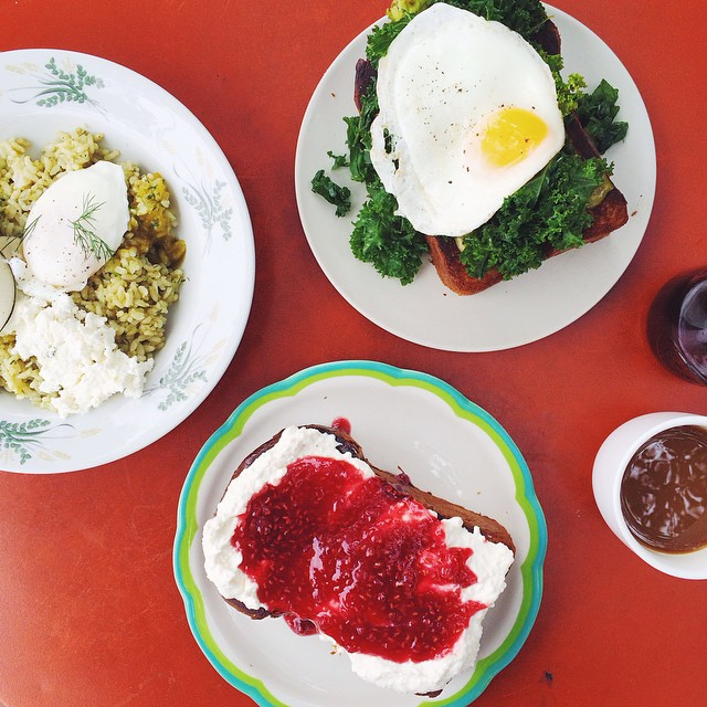 OMG y'alls. Housemade ricotta toast with raspberry vanilla jam; open faced brioche toast topped with kale, tomatillo purée, housemade hot sauce and a fried egg; and sorrel pesto brown rice bowl (talk about this more later). The toast was at least 3 inches high.  Burnt and caramelized on the outside and light and airy in the middle.  Amaze. @sqirl_confitures